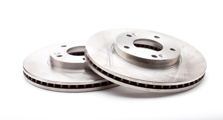 Studio shot of two front brake disks for a modern car isolated on a white background