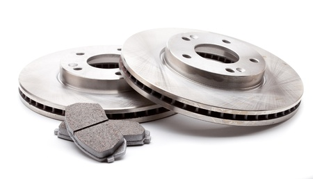 disk: Studio shot of two front brake disks and pads for a modern car isolated on a white background