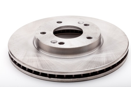 Studio shot of a front brake disk for a modern car isolated on a white background photo