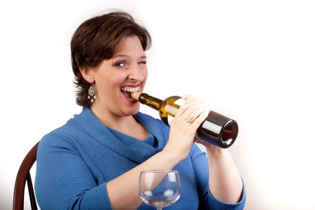 Woman pulling a wine cork out with her teeth Stock Photo - 14094468