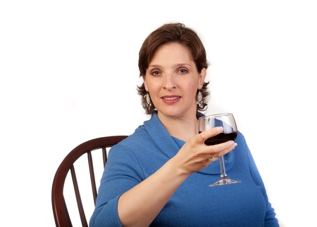 Studio shot of a mature, pretty woman drinking red wine Stock Photo - 14094448