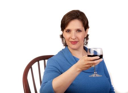 Studio shot of a mature, pretty woman drinking red wine Stock Photo - 14094447