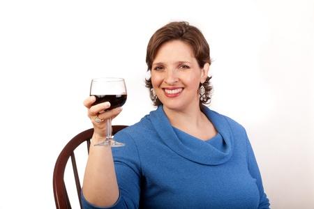 Studio shot of a mature, pretty woman drinking red wine Stock Photo - 14094466