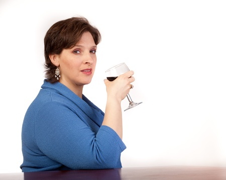 Studio shot of a mature, pretty woman drinking red wine Stock Photo - 14094434