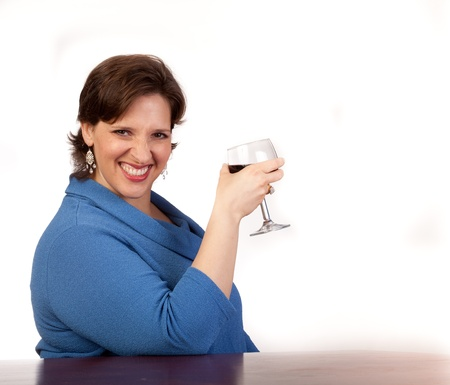 Studio shot of a couger drinking red wine Stock Photo - 14094438