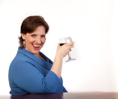 Studio shot of a couger drinking red wine Stock Photo - 14094441