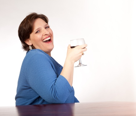 Studio shot of a couger drinking red wine Stock Photo - 14094443