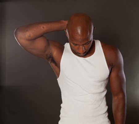 sexy muscular man: Young, handsome, muscular black man in a t-shirt