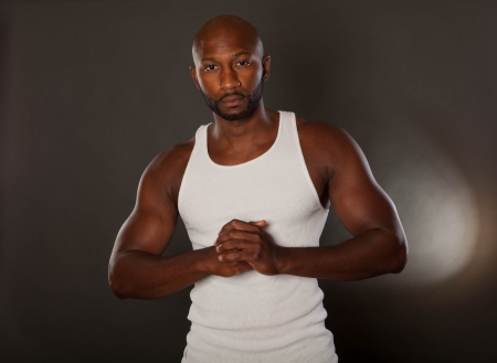 Young, handsome, muscular black man in a t-shirt photo
