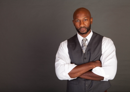 Young black business man wearing a suite and tie photo