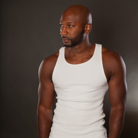 rugged man: Young, handsome, muscular black man in a t-shirt
