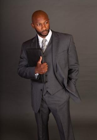 masculine: Young black business man holding a portfolio Stock Photo