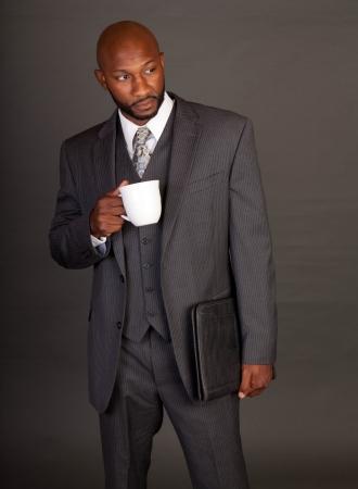 Young black business man holding a portfolio Stock Photo - 14447980