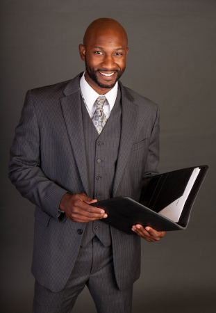 Young black business man holding a portfolio Stock Photo - 14447994