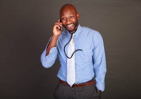 African American  Black doctor checking his cell phone photo