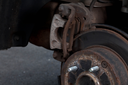 Rear brack disk with caliper partially removed about to be replaced Stock Photo - 15493776