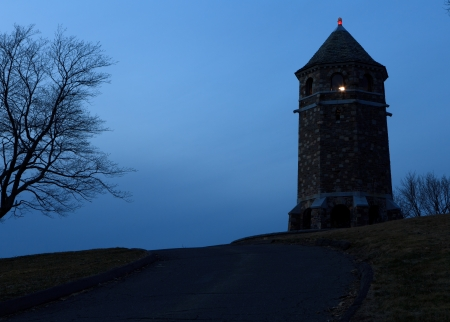 After sunset shot of a stone war memorial on a hill with red beacon and tower light on Stock Photo - 16145751