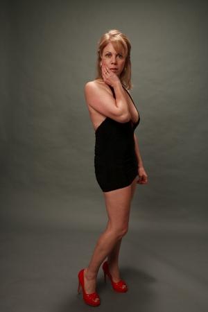beautiful cleavage: Older woman in black dress