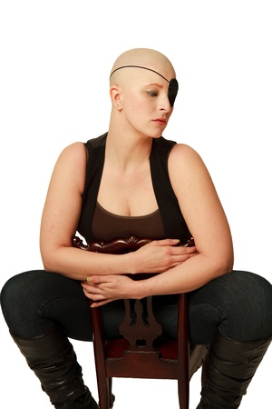 skinhead: Studio shot of a bald girl with an eye patch