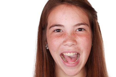freckles: Bright picture of a healthy, teenage girl with long brown hair on isolated white background Stock Photo