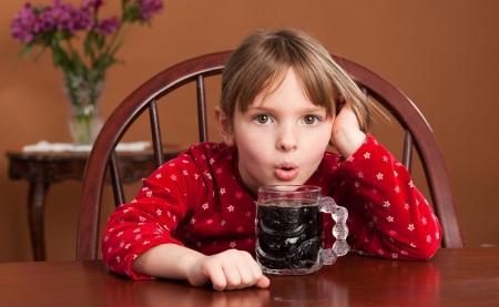 Breakfast Beverage Confusion - 5 y o child reacts to being served black coffee Stock Photo - 16084969