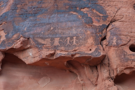 3,000 year old Native American petroglyphs carved in red sandstone in the southwestern USA desert  photo