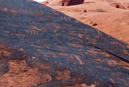 iron oxide: 3,000 year old Native American petroglyphs carved in red sandstone in the southwestern USA desert