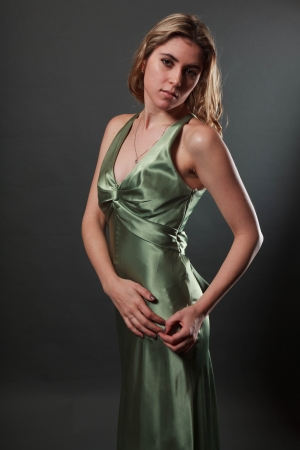 evening gown: Studio portrait of a sexy blonde girl in an evening gown