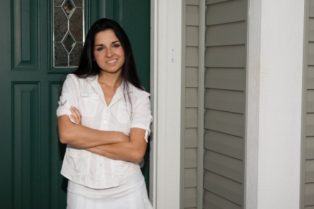 Woman smiling at the front door Stock Photo - 16946069