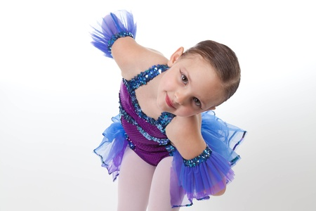 5 year old girl: 5 Year old girl with dancing costume on a white background Stock Photo
