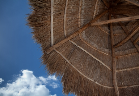location shot: Location shot of a thatched umbrella
