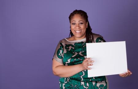 spokesperson: Beautiful plus size black woman holding a sign Stock Photo