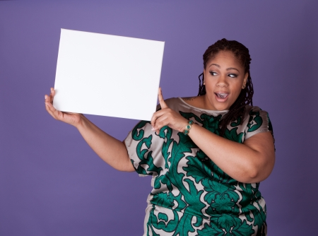 bbw: Beautiful plus size black woman holding a sign Stock Photo