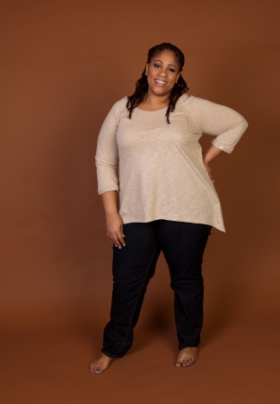 bbw: Beautiful plus size black woman standing on a brown background