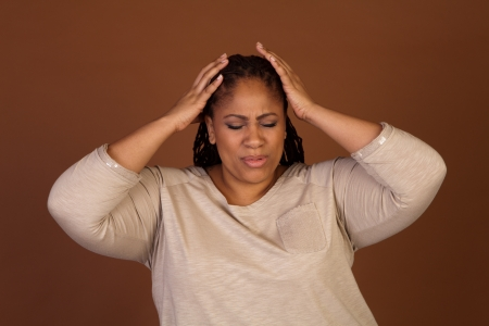 shadow woman: Frustrated beautiful plus size black woman standing on a brown background