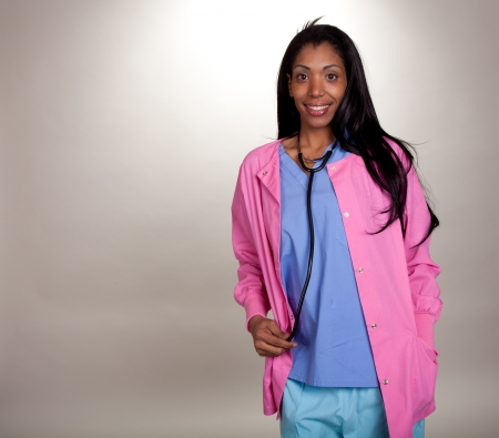Happy medical Provider in scrubs with a stethoscope photo