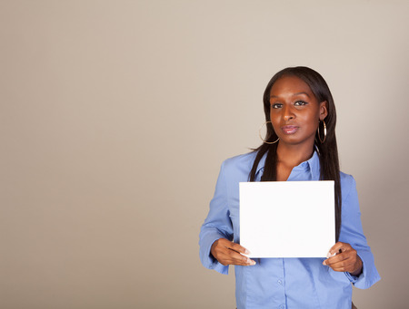 Black woman holding a white sign with room for copy Stock Photo