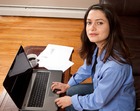 Woman working at home on a laptop computer Stock Photo