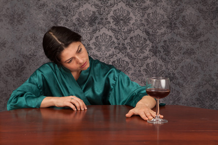 alcohol abuse: Young woman struggling with alcohol abuse