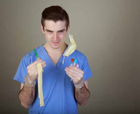 phlebotomist: Young male phlebotomist with equipment for drawing blood