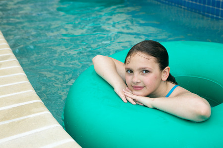 location shot: Location shot of a  young girl on a bluegreen innertube in a lazy river in Myrtle Beach South Carolina