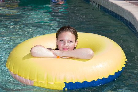 sc: Ten year old girl  relaxing on vacation in a lazy river in a resort in Myrtle Beach, SC