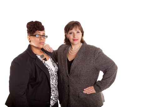 Two confident plus size mixed race business women on a white background in a serious confident pose part of a series Standard-Bild