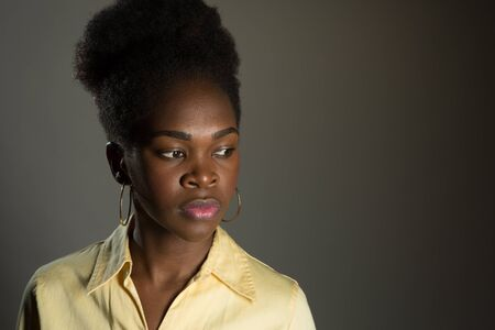 Nice Studio shot of a 20 year old African American girl in a business casual outfit