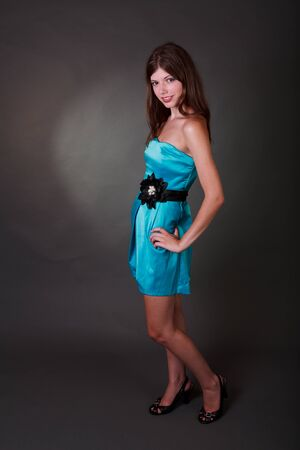 Fashion photo of young magnificent woman in blue club dress 写真素材