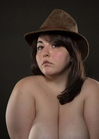 Implied topless BBW - Large frame - woman with brown hair posing in the studio 写真素材