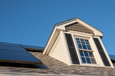 Solar panels on a home with blue sky. Renewable energy concept image.