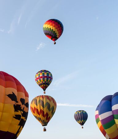 Nice shot of a hot air balloon as it takes flight over New England Stock Photo