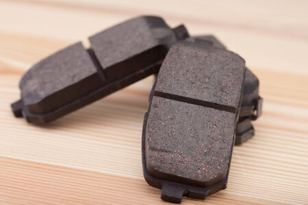 New brake  pads with wrenches on a woden workbench