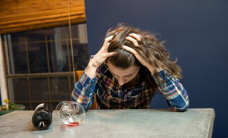 Woman passed out with glass of wine. Alcohol abuse and addition concept image.